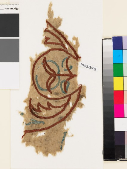 Textile fragment with plant, circle, and leaves