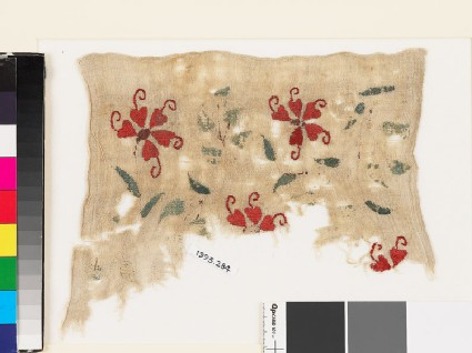 Textile fragment with plants, tendrils, and leaves