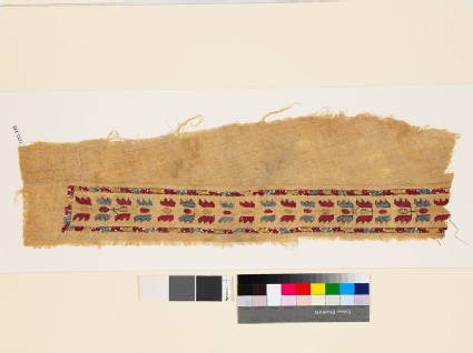 Textile fragment with band of floral shapes