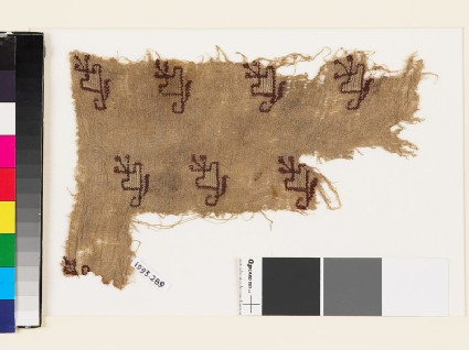 Textile fragment with floral shapes