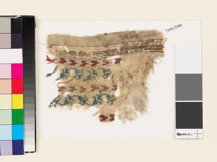 Textile fragment with chevrons and a floral scrolled stem