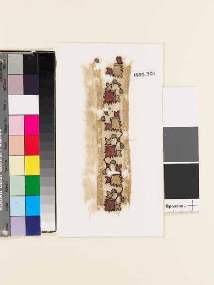 Textile fragment with stylized flower-shapes