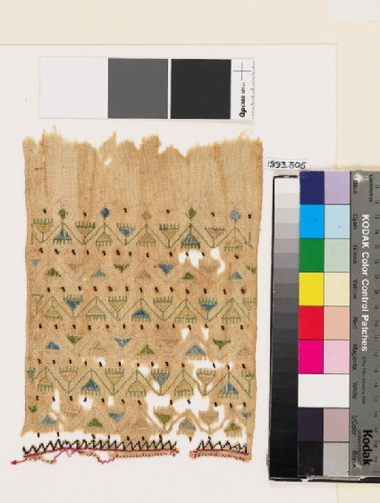 Textile fragment with chevron stems, triangular flowers, and zigzag