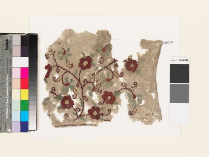 Textile fragment with floral spray
