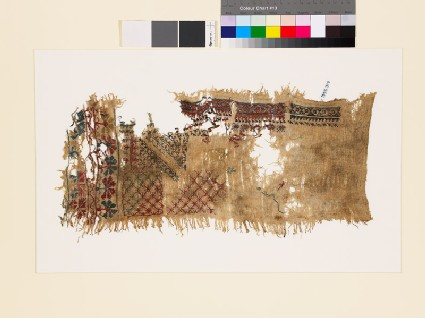 Sampler fragment with lattice, stars, and geometric and floral shapes