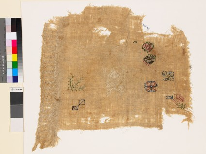 Sampler fragment with flowering plants, geometric whitework, and chevrons