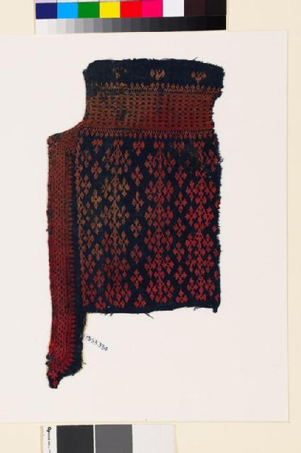 Textile fragment from the neck of a garment with linked diamond-shapes and lattice