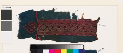 Textile fragment from a garment with linked diamond-shapes and double hearts