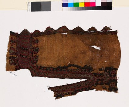Textile fragment from the neck of a dress with stylized floral shapes