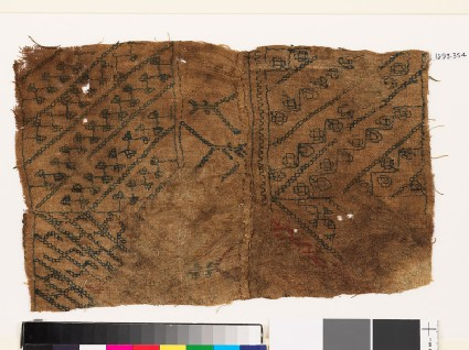 Sampler with diagonal lines, hooks, and stylized flower-heads