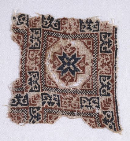 Textile fragment with star and pseudo-inscription
