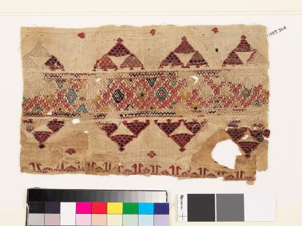 Textile fragment with band of diamond-shapes, triangles, and pseudo-kufic inscription