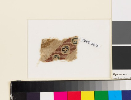Textile fragment with diagonal band of rosettes in squares