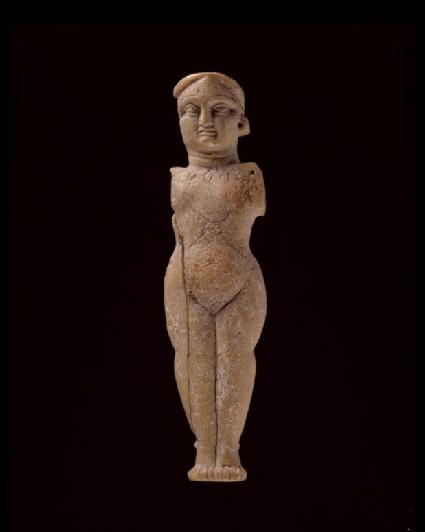 Female figure wearing jewellery