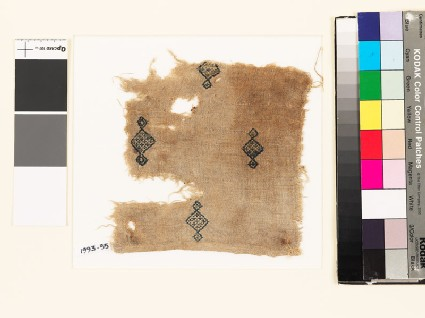 Textile fragment with diamond-shaped medallions and crosses