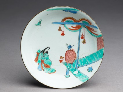 Saucer depicting a woman in Heian period dress with a bird