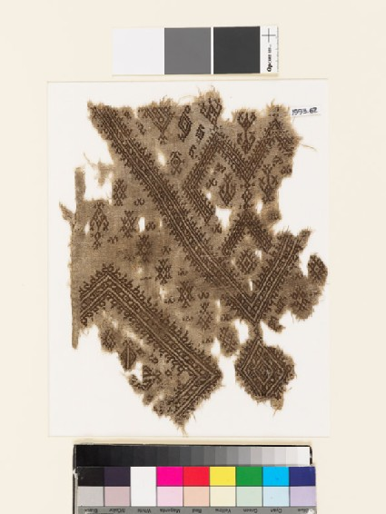 Textile fragment from the neck of a garment with geometric shapes