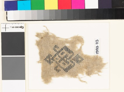 Textile fragment with geometric heart-shaped medallion