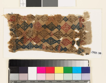 Textile fragment with linked diamond-shapes and palmettes, probably from a belt