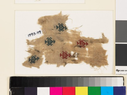 Textile fragment with heart-shaped medallions, triangles, and hooks