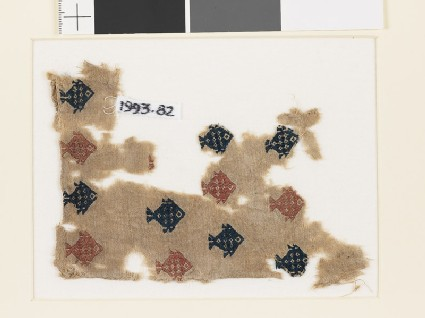 Textile fragment with diamond-shaped fish