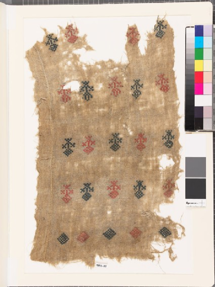 Textile fragment with stylized floral shapes and diamond-shapes