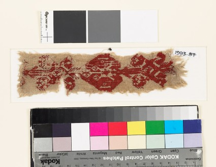 Textile fragment with diamond-shaped medallion and floral shapes, possibly from the neck of a tunic