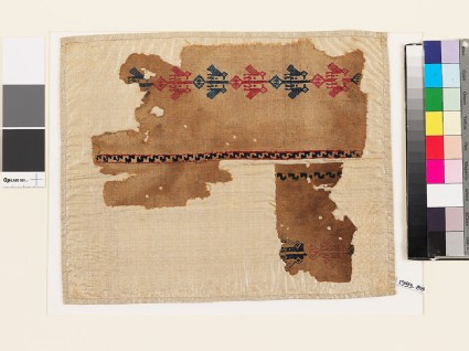 Two textile fragments with paired birds and diamond-shapes
