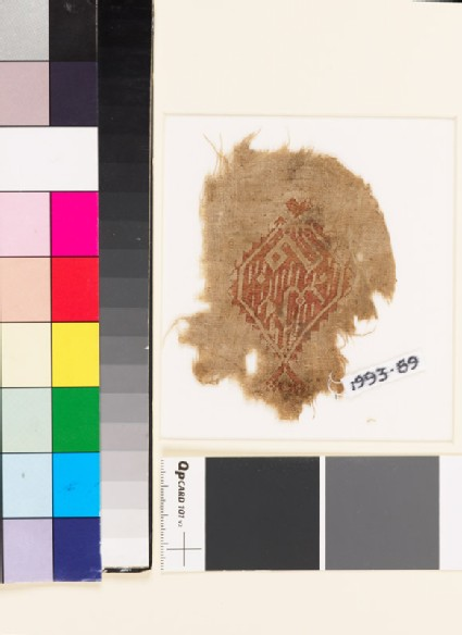 Textile fragment with diamond-shaped medallion and pseudo-kufic inscription