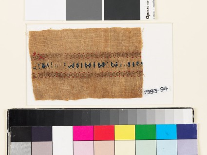 Textile fragment with pseudo kufic inscription