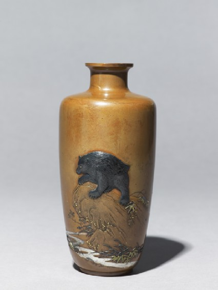 Baluster vase with a bear on a rock