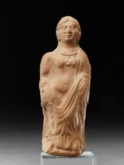 Plaque with semi-draped female figure