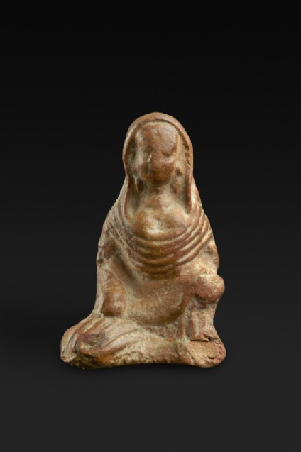 Figure of a seated woman with cloth draped over head