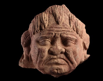 Head of a grimacing yaksha, or nature spirit