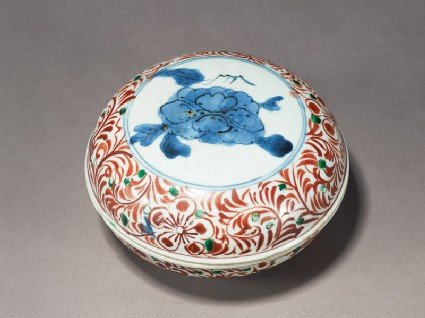 Box with peony enclosed by a floral scroll border
