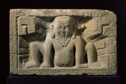 Stone slab with yaksha, or nature spirit, in relief