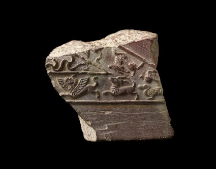 Fragment of a jeweller's mould with animals and birds in relief