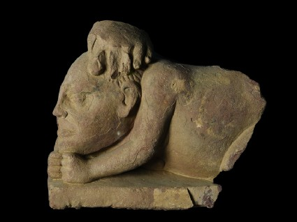Fragmentary figure of a crouching yaksha, or nature spirit