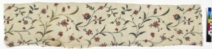 Embroidery fragment with flowering tendril design