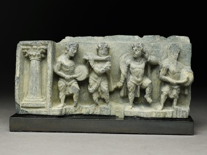 Relief fragment depicting a dancer and three musicians