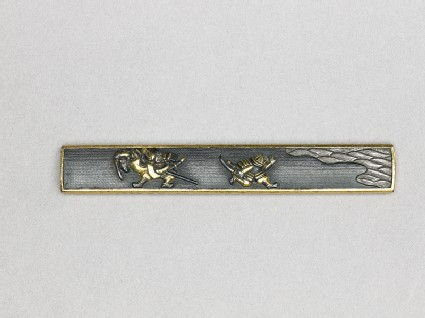 Kozuka with design of samurai and waves