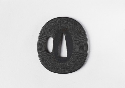 Oval tsuba with simple punched nanako decoration
