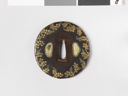 Round tsuba with design of flowers