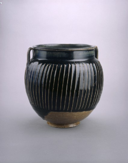 Black ware jar with white stripes