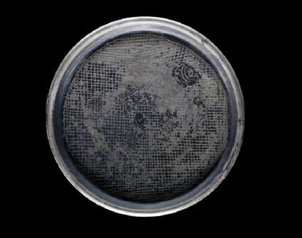 Dish decorated with fish incised on a cross-hatched background