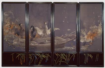 Screen with cormorants fishing at night