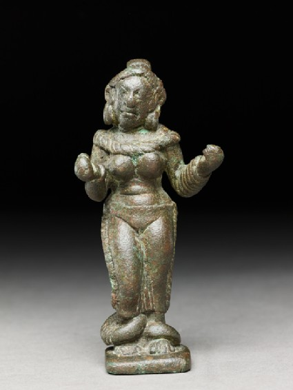 Female figure with heavy anklets