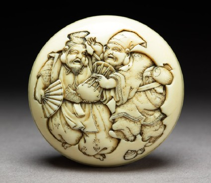 Manjū netsuke depicting the gods Daikoku and Ebisu dressed as manzai dancers