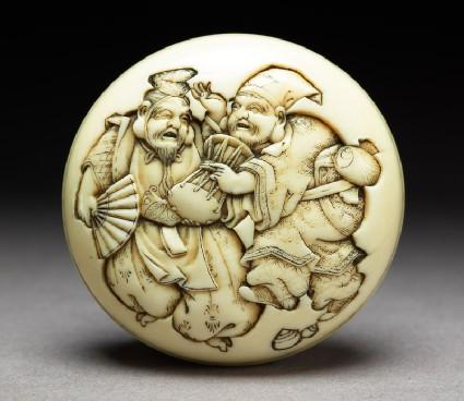 Manjū netsuke depicting the gods Daikoku and Ebisu dressed as manzai dancers