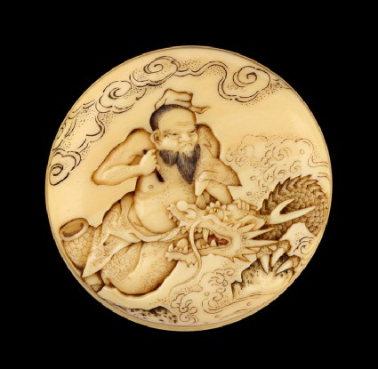 Manjū netsuke depicting the Daoist immortal Bashikō performing acupuncture on a dragon